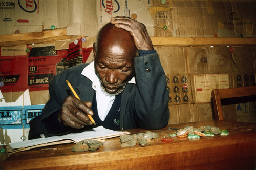 The late Maruge concentrates on his school work. (PIX: Courtesy)